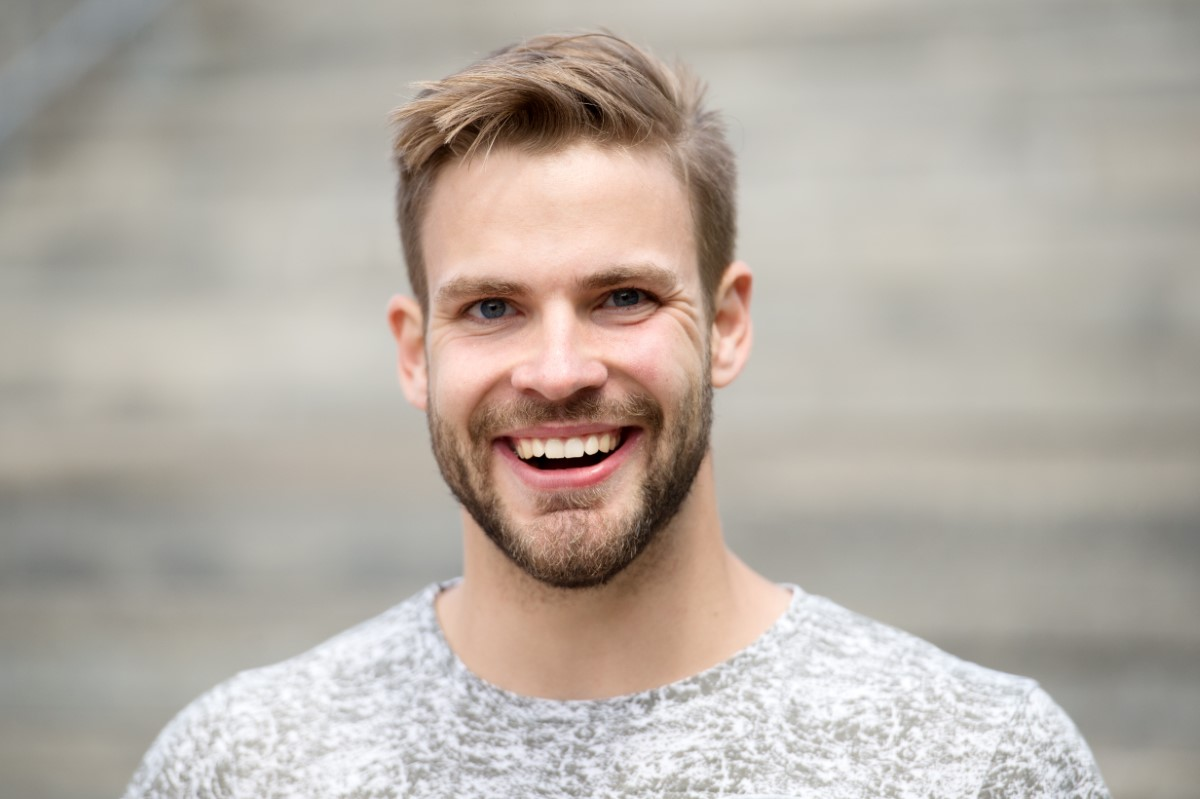 Man With Perfect Brilliant Smile Unshaven Face Defocused Backgro